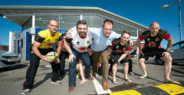 Motor dealer gives rugby club a boost, gets one back