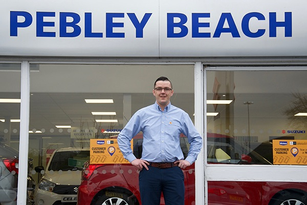 New manager was selling cars before he was old enough to drive