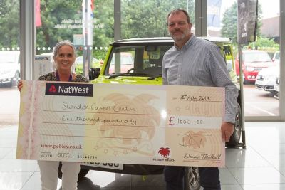 Motor dealer backs socially-distanced sponsored walk in aid of carers